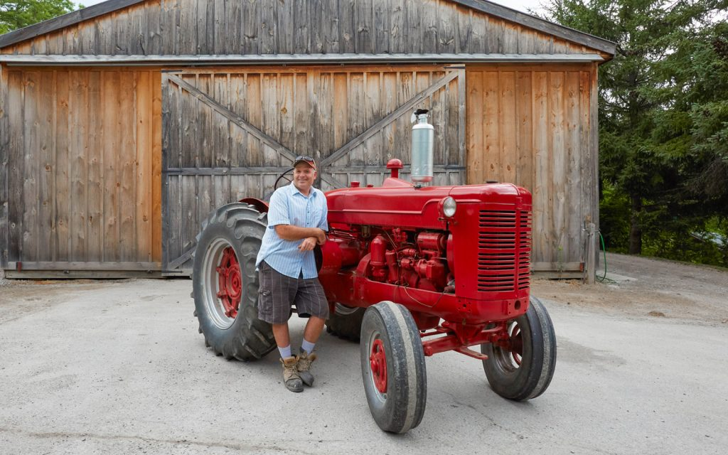 Brent and a historic tractor at Cedar Springs