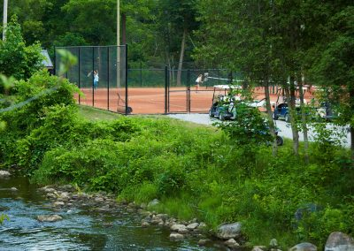 A view of the tennis courts from across the creek