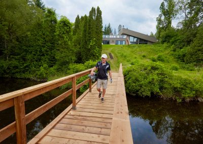 Walking across bridge on first hole at Cedar Springs